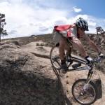 Rusty drops an optional slick rock line on Rattlesnake trail.