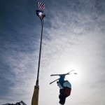 Joey front flips next to the flag pole.