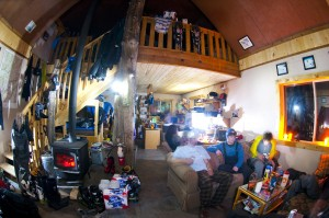 The crew settles into the cabin for a night of warm food and cold beers after a great day of skiing. Photo: Trent Bona