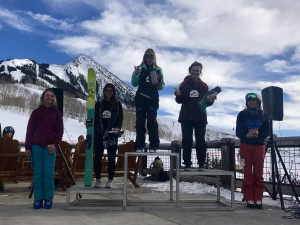 Ella Haverkampf in 1st, Austin Obourn in 2nd, and Avery Bernholtz in 3rd on the 12-14 ski female podium.